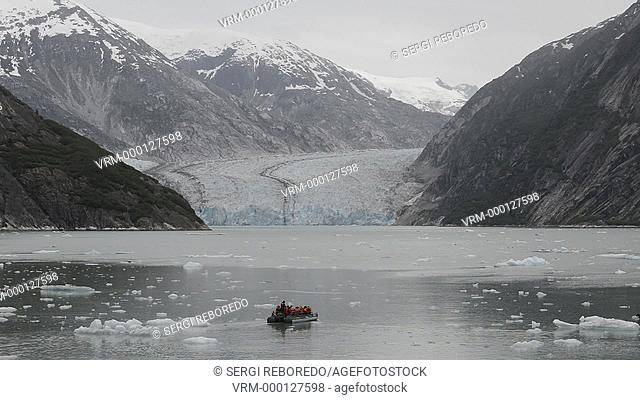 Safari Endeavour cruise passengers in an inflatable boat in front of South Sawyer Glacier calves into the Endicott Arm fjord of Tracy Arm in Fords Terror...