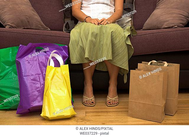 Woman rests after a hard day shopping