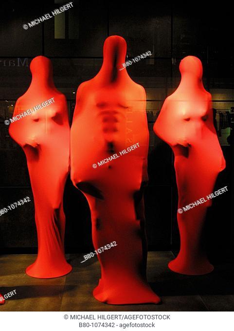 Red mantled dummies, shop-window, window-shopping, Hamburg, Germany