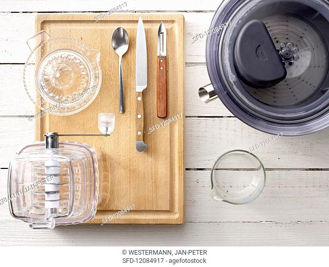 Utensils for preparing juices: a juicer, ice crusher and citrus press