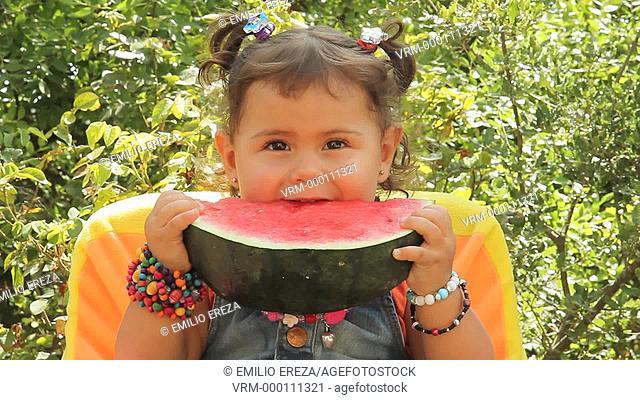 Little girl eating a watermelon