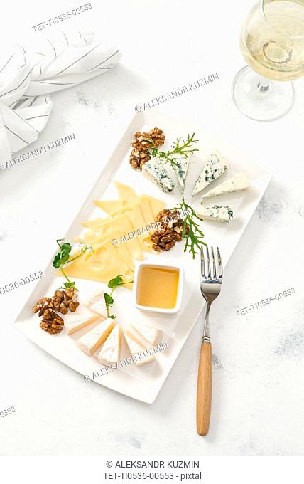 Cheese plate by glass of white wine