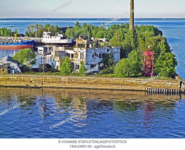 Kotlin Island 20 miles west of St. Petersburg, Russia. A Kronshtadt harbor lighthouse and Russian Naval vessels are shown here