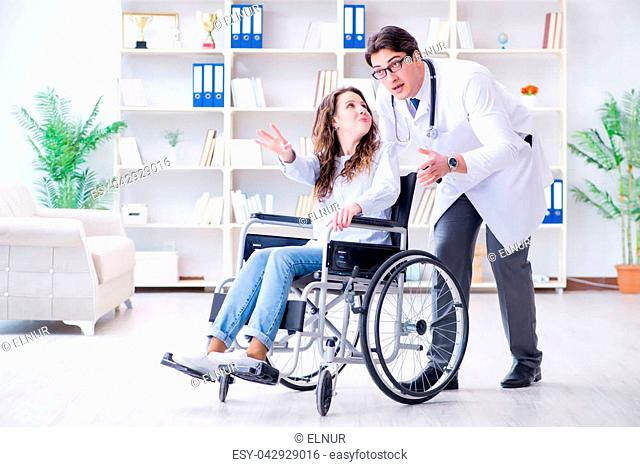 Disabled patient on wheelchair visiting doctor for regular check up