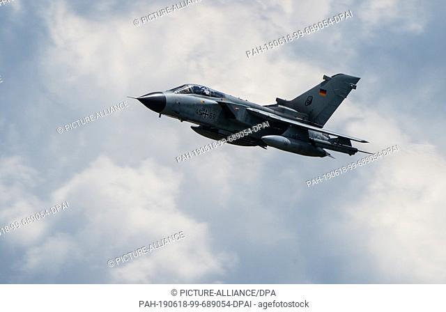 "13 June 2019, Lower Saxony, Faßberg: A Panavia 200 (PA-200) Tornado multi-purpose combat aircraft flies over the air base Faßberg on """"Spotter Day"""""