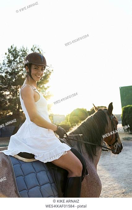 Portrait of smiling woman on horse