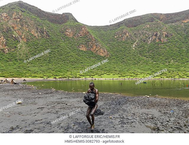 Ethiopia, Oromia, El Sod, Borana tribe man carrying salt taken from the lake of el sod volcano