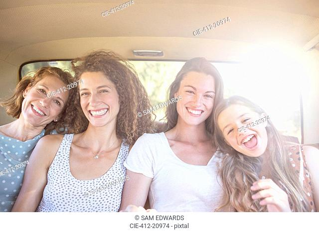 Four women sitting in backseat of car