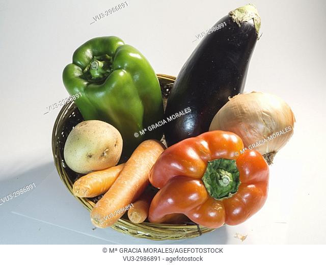Basket of vegetables on white bakcgroun