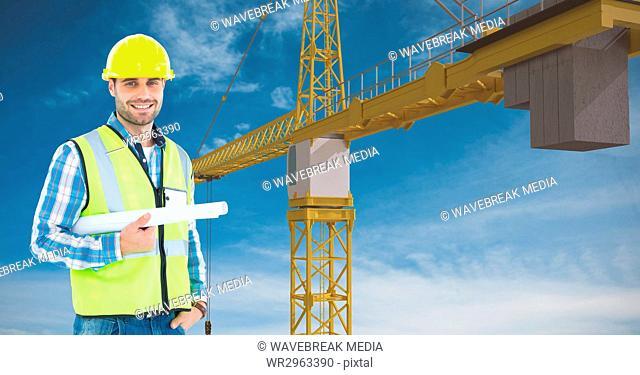 Architect holding blue prints against crane