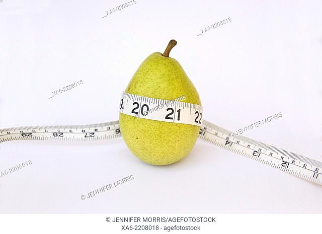 A pear with a measuring tape around it