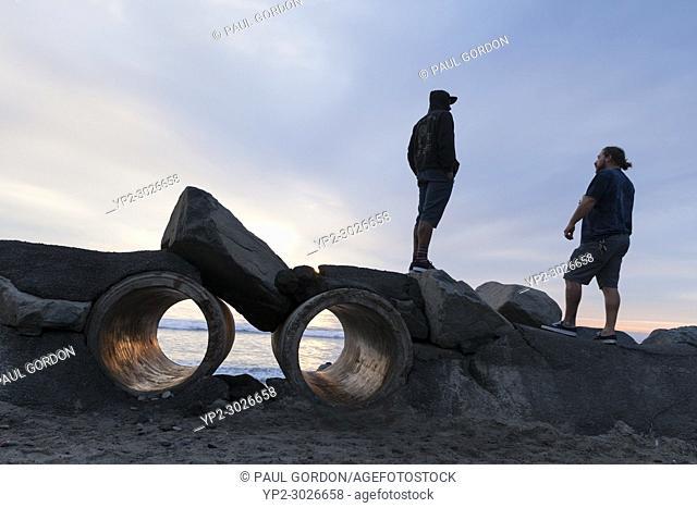 Oceanside, California: Two friends on the seawall at Buccaneer Beach