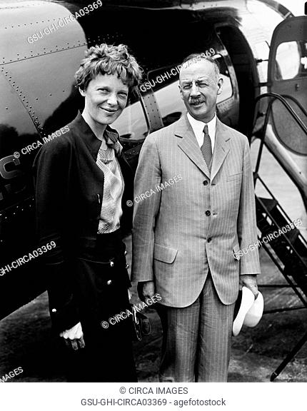 Amelia Earhart (L), Portrait with Man in front of Airplane, Harris & Ewing, 1932