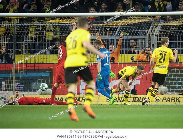 11 March 2018, Germany, Dortmund: Bundesliga, Soccer, Borussia Dortmund vs. Eintracht Frankfurt at the Signal Iduna Park: The ball lies in the goal after...