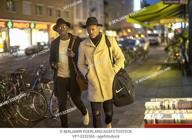 streetstyle, night, two man walking on pavement, street, city, Munich, Germany