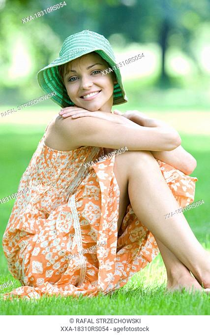 young woman smiling in park