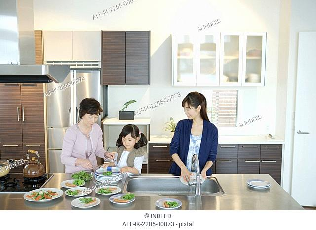 Asian family serving food in plates