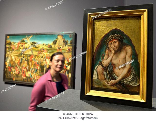 "A woman stands in front of the work A woman looks at the """"Christ as Man of Sorrows"""" (1492/93) by Albrecht Duerer at the Staedel Museum in Frankfurt Main"