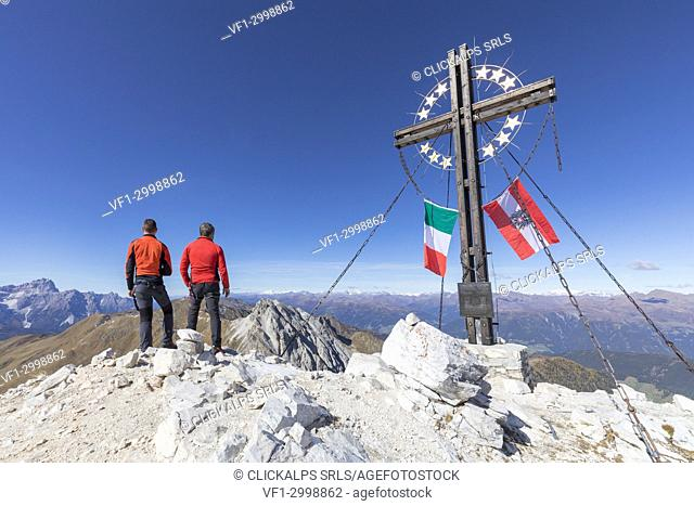 the peak of the mount cavallino (Gr. Kinigat) on the border between Italy and Austria with the cross of Europe and the flags of the two states, Kartitsch