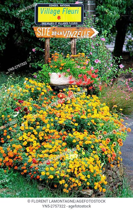 Entrance of vllage of Vinzelle, Aveyron, Midi Pyrénées, Occitanie. Flower bed