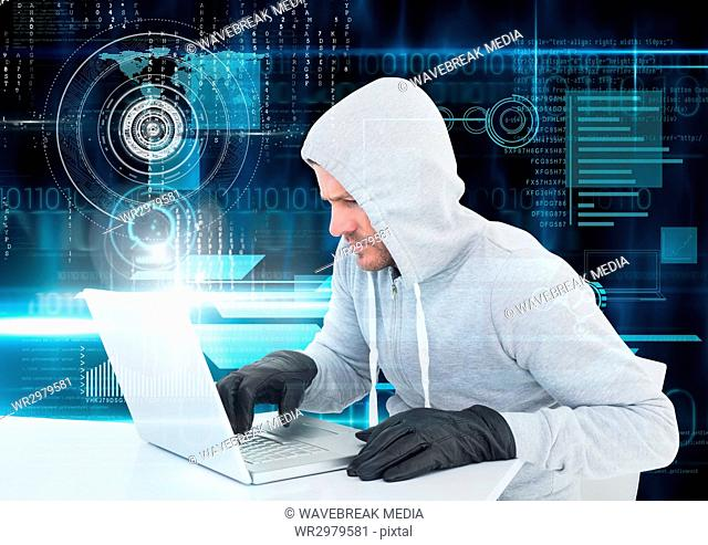 Hacker with glove using a laptop in front of digital background