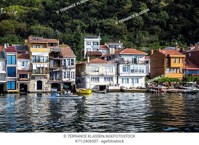 Waterside homes reflected in the Bosphorus at the fishing village of Anadolu Kavagni near Istanbul, Turkey