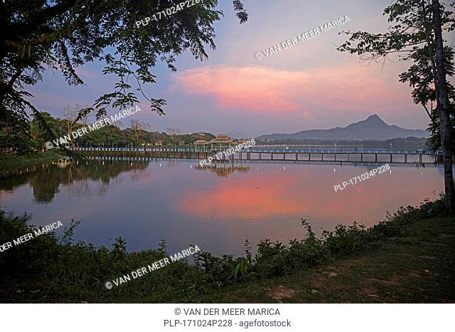 Wooden bridge over Kan Thar Yar Lake at sunset, Hpa-an, Kayin State / Karen State, Myanmar / Burma