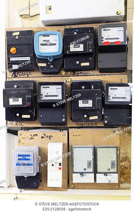 Electric meters attached to a makeshift wooden panel
