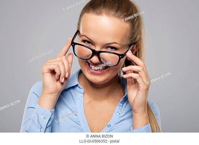 Cute young businesswoman wearing fashion glasses, Debica, Poland
