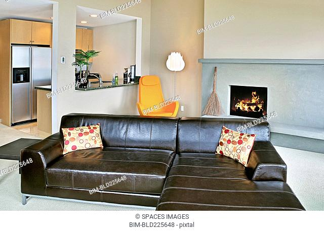 Sectional sofa and kitchen in modern home