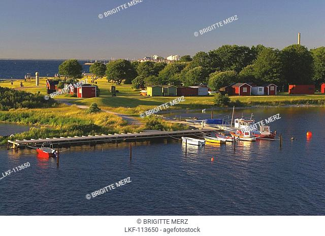 Beach and harbour near the bridge over the Oeresund near Malmoe, Skane, southern Sweden