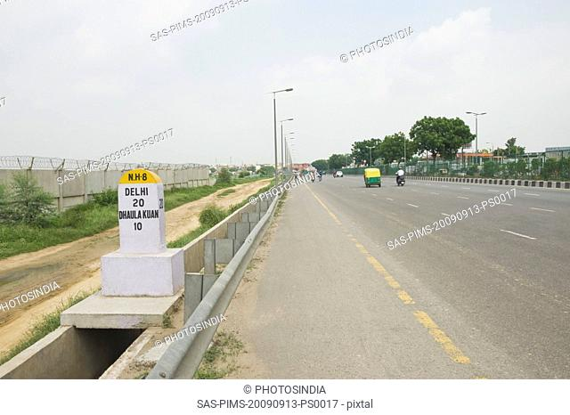 Milestone at the roadside, National Highway 8, New Delhi, India