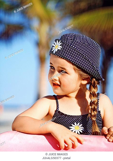 Portrait, young girl in sun hat