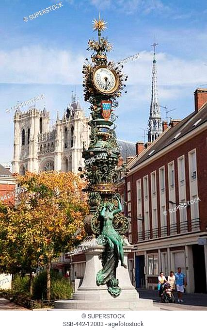 Clock tower with a cathedral in the background, Notre Dame d'Amiens, Amiens, Somme, Picardy, France
