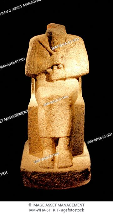 Seated figure of king Aramatelqo with hieroglyphic inscription Napatanisch, c. 550 BC grey Granite