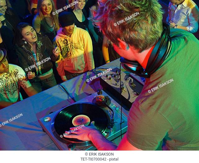 DJ playing in front of crowd