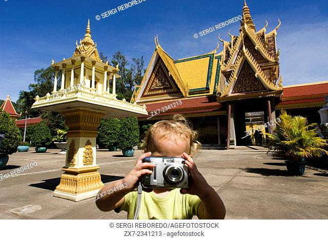 Child walking alone and take pictures in Royal Palace. Phnom Penh. The Royal Palace in Phnom Penh was constructed over a century ago to serve as the residence...