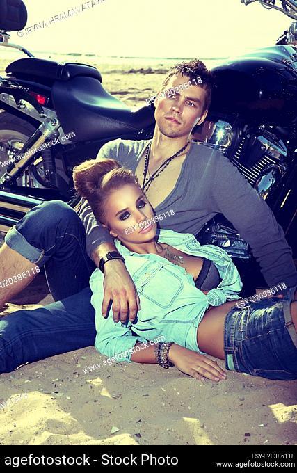 Travel destination. Man and woman resting near motorbike