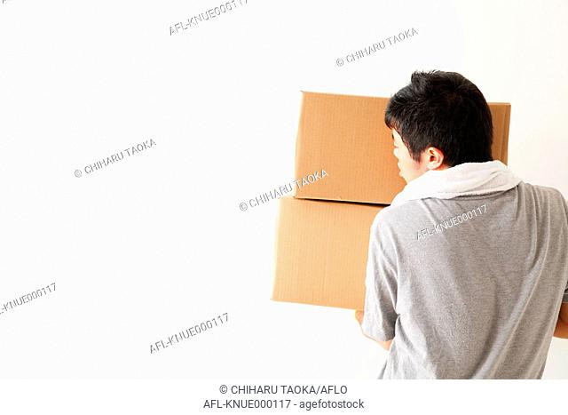 Japanese man with heavy boxes