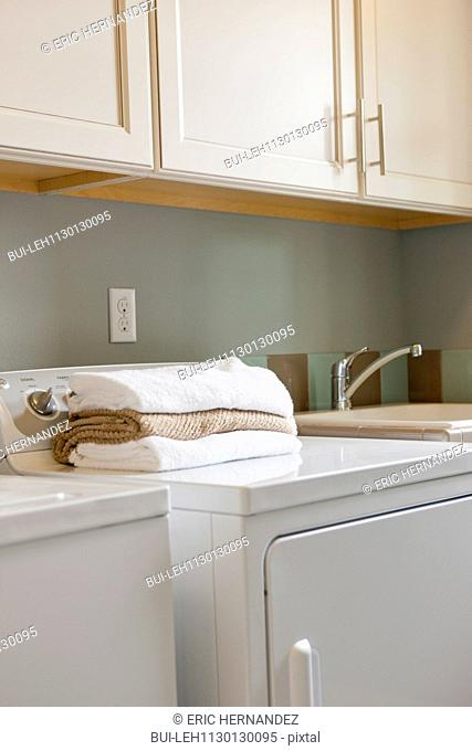 Towels on washing machine in utility room