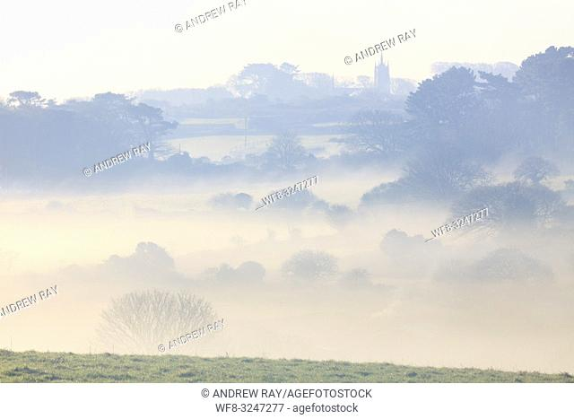 Mist in the Poldice Valley in mid Cornwall, captured from Wheal Bush in late January with St Day Old Church in the distance
