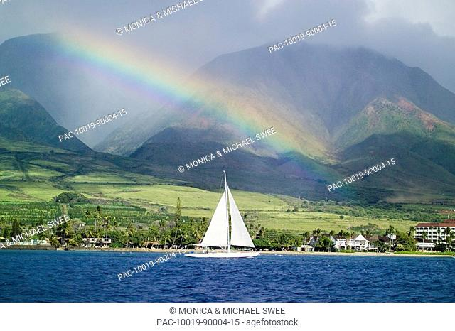 Hawaii, Maui, Lahaina, Rainbow in front of West Mauis mountain range with sailboat in ocean