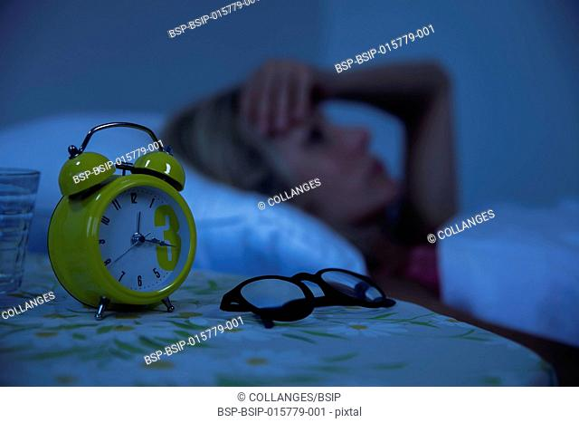 Woman struggling to wake up in the morning