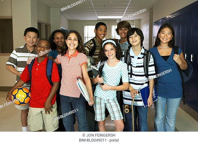Group of multi-ethnic students in hallway