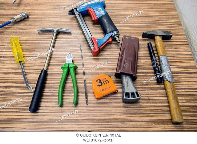 Tilburg, Netherlands. Tools organized neatly on a workbench in the workshop of a furniture upholstery