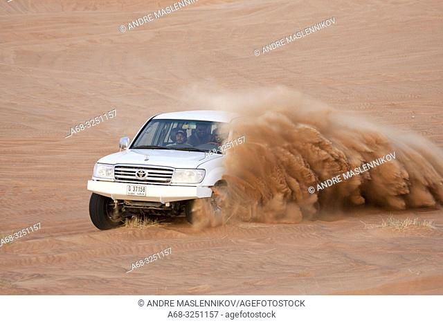 Driving in the desert in a Toyota Landcruiser