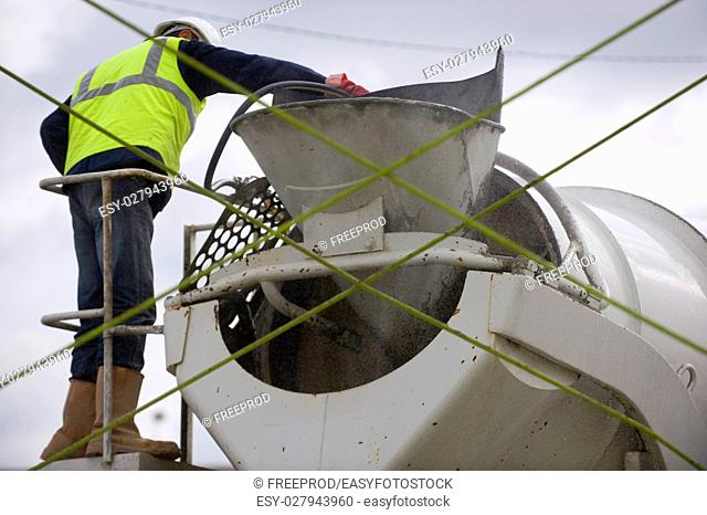 Worker and Truck with cement mixer, France