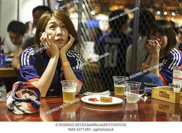 Soccer fans react as they watch the FIFA World Cup Group H match between Poland and Japan at Hooters restaurant in Shibuya on June 29, 2018, Tokyo, Japan