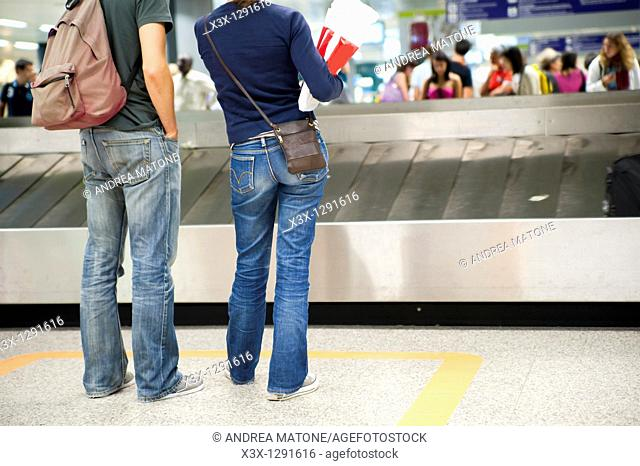 Passengers waiting for their luggage at the airport