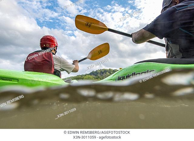 Two males on kayaking tour on the Potomac River at Great Falls. USA